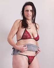 Sexy mature lady strips for your pleasure